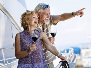 Elderly couple drinking wine and enjoying retirement thanks to financial advice from Action Accounting